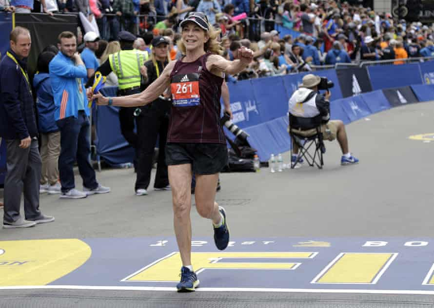 Kathrine Switzer, 70, crosses the finish line in the Boston Marathon.