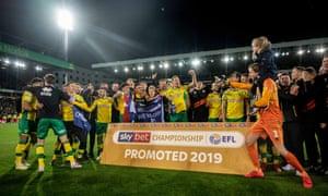 Norwich celebrate promotion to the Premier League.