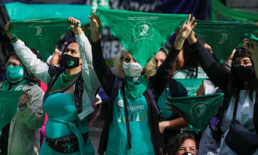 Activists hold green handkerchiefs, a symbol of the pro-abortion movement, during a demonstration in Buenos Aires, Argentina.
