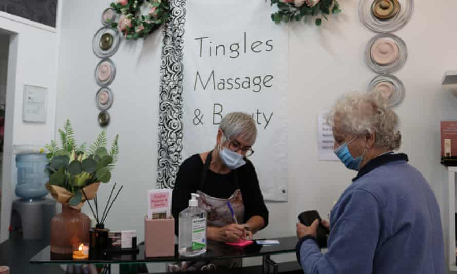 Cynthia Anderson, the owner of Tingles Massage and Beauty in Gilgandra, serving a vaccinated customer