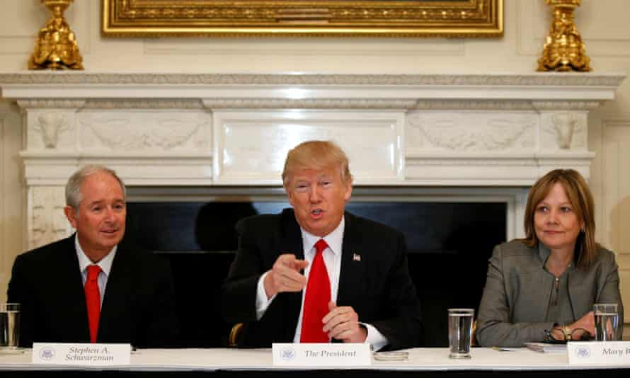 Trump flanked by Blackstone CEO Stephen Schwarzman, a Momentive investor and Trump's 'jobs czar', and General Motors CEO Mary Barra.