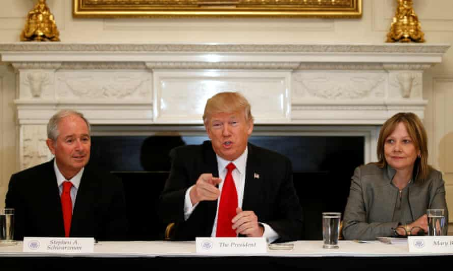 Trump flanked by Blackstone CEO Stephen Schwarzman and General Motors CEO Mary Barra, both bosses have expressed concern about climate change