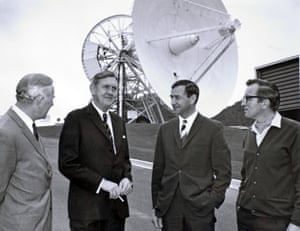 Prime Minister Gorton (second left) and Tom Reid (right) pose in front of the Honeysuckle dish, which has been moved out of tracking alignment for this photo.