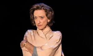 Haydn Gwynne's Hedda Tesman, dressed in silk pyjamas, wraps her arms around her