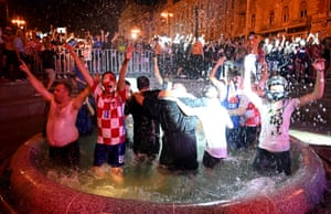 Croatian supporters bathe in a fountain as they celebrate after their team beat Scotland.