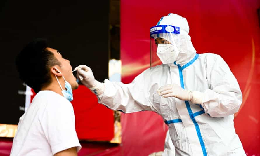 China Yunnan Ruili Covid 19 Test - 05 Jul 2021Mandatory Credit: Photo by Xinhua/REX/Shutterstock (12196225e) A medical worker collects a swab sample for nucleic acid test in Ruili City of southwest China's Yunnan Province, on July 5, 2021. Ruili City on Monday imposed entry and exit restrictions after the emergence of new COVID-19 cases. The city reported three new locally transmitted confirmed COVID-19 cases on Sunday. Authorities have asked people to refrain from entering or leaving the city unless necessary. China Yunnan Ruili Covid 19 Test - 05 Jul 2021