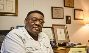 Isaiah 'Ike' McKinnon in his office. He is former Detroit police chief , deputy mayor, and now associate professor of education at the University of Detroit Mercy.