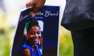 A woman carries a program following the funeral service for Sandra Bland in Lisle, Illinois, on 25 July 2015.