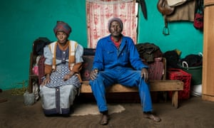 Xolisile Butu with his mother, one of thousands of former miners involved in the suit.