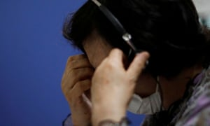 A volunteer responds an incoming call at the Tokyo Befrienders call centre.