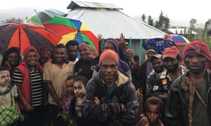 Uma residents stand outside a medical clinic built by the International Committee of the Red Cross