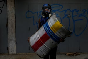 In Venezuela's anti-government unrest, youths bear colourfully decorated homemade shields akin to those used in Kiev's Maidan Square