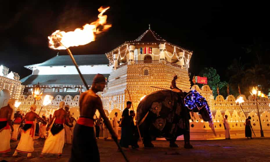 Traditional dancers take part in Kandy's Esala Perahera, or The Festival of the Tooth.