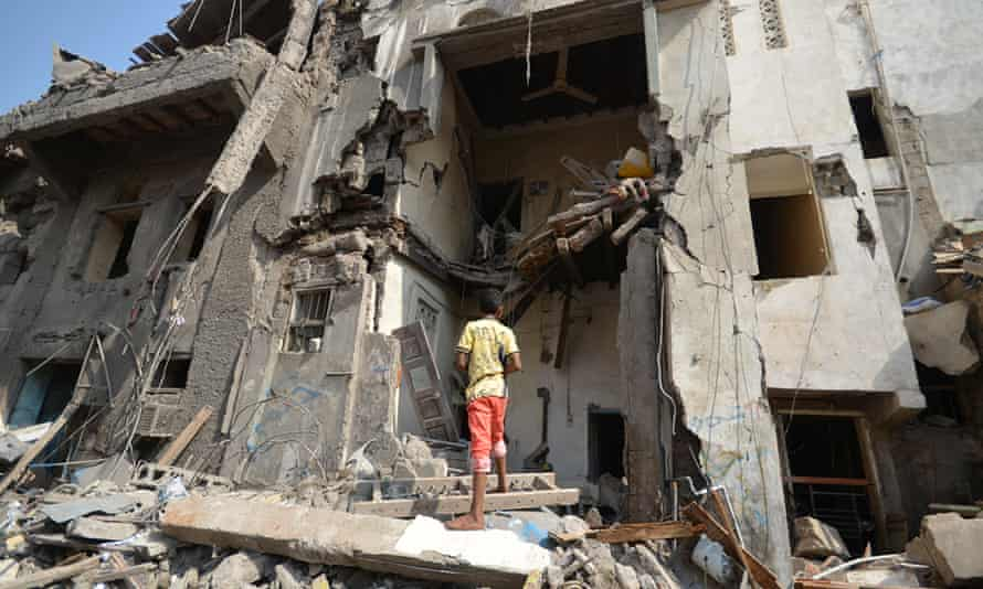 A bgoy looks at a damaged house at the site of a Saudi-led air strike in the Red Sea port city of Hodeidah.