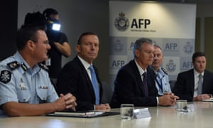 Australian Prime Minister Tony Abbott and Australian Security Intelligence Organisation (Asio) director general of security Duncan Lewis, with members of the Australian Federal Police.