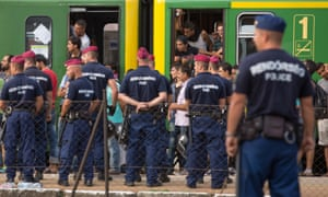 Hungarian police stop a train with refugees in Bicske.