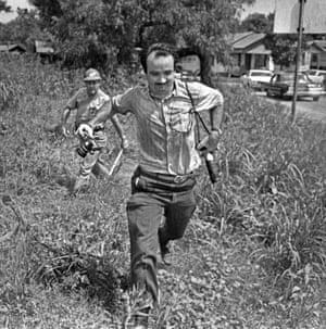 An undated picture of Matt Herron fleeing a policeman