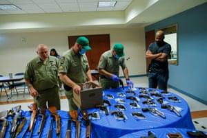 Men in a room wth guns