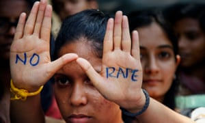 An Indian student displays a 'No Rape' message painted on her hands during a demonstration to demand the death sentence for four men convicted in the Delhi rape case.