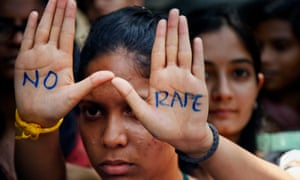 The hands of an Indian student demonstrating in Hyderabad after the gang rape and murder of Jyoti Singh in 2012 bear the message 'No rape'.