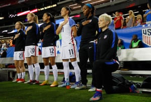 Rapinoe kneels during the national anthem before the match between the United States and the Netherlands at Georgia Dome on 18 September 2016.