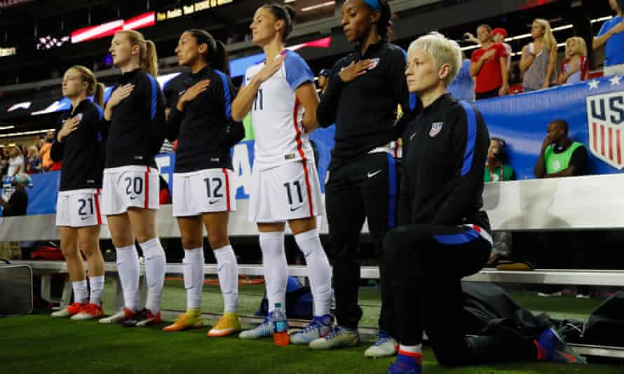 Megan Rapinoe kneels during the national anthem prior to a match between the United States and the Netherlands in 2016