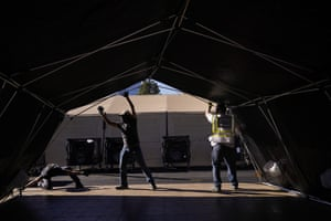 Volunteers in southern California help build a mobile field hospital. The state's overwhelmed hospitals are setting up makeshift extra beds for coronavirus patients.