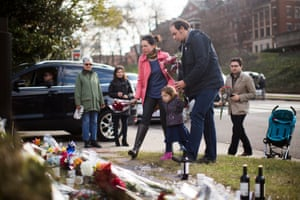 Visitors leave flowers at a memorial outside the French embassy in Washington DC in tribute to the victims of the Paris attack