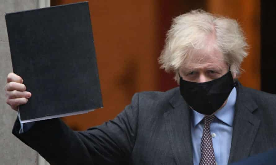 Boris Johnson leaves 10 Downing Street to give his roadmap speech to parliament on 22 February.