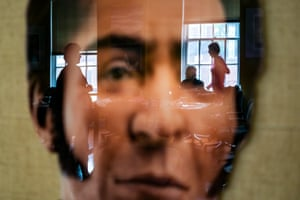Medea Benjamin, right, co-founder of the activist group CodePink, is seen in a reflection of a portrait of Simon Bolivar as she occupies the Venezuelan embassy in Washington DC. Activists are opposed to a forced handover of diplomatic buildings belonging to the Maduro government. The Trump administration ordered diplomatic staff to vacate the building by 24 April.