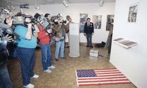 Photographers focus their cameras on the Dread Scott exhibit in March 1989.
