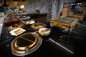 Gold-plated serving dishes and cutlery