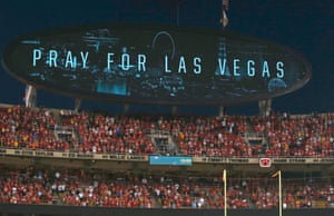 A message on a video board during a moment of silence before Kansas City Chiefs' NFL game against Washington Redskins in Kansas City, Missouri