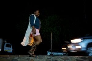 Makananelo Mochasane, a 36-year-old sex worker, walks along the roadside in Maseru