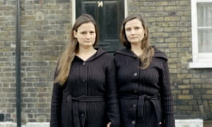 The twins which feature in the art exhibition Die Familie Schneider, an installation by Gregor Schneider, based in two houses in Whitechapel, East London. They are photographed outside one of the houses. Dec 2004