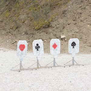 Suits and shoots … cards used as targets at a tournament held by the Old Western Shooting Society, at the Devil's Club range in Arezzo, Tuscany