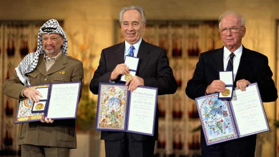 Arafat, Peres and Rabin with their Nobel awards in Oslo, Norway, in 1994.
