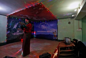 Lhaden, 38, a divorced mother-of-two, performs in a bar in Thimphu. She dances until midnight to traditional folk songs, or sometimes Bollywood songs, chosen by customers.