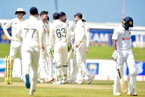 Jimmy Anderson celebrates with his team mates after taking Oshada Fernando's wicket.