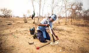 Zeferina Victori  clearing landmines near the village of Cabio in Angola.