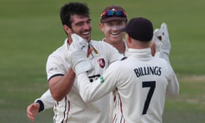 Grant Stewart celebrates with team-mates Joe Denly and captain Sam Billings following promotion.
