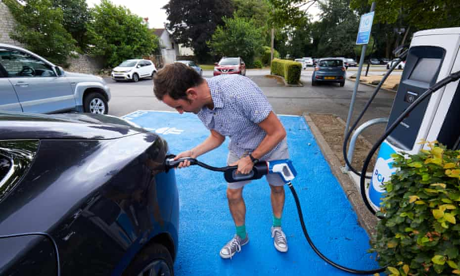 Guardian journalist Adam Vaughan charging a Tesla car at a Polar electric vehicle station at the Holiday Inn hotel off the A1 in Doncaster.