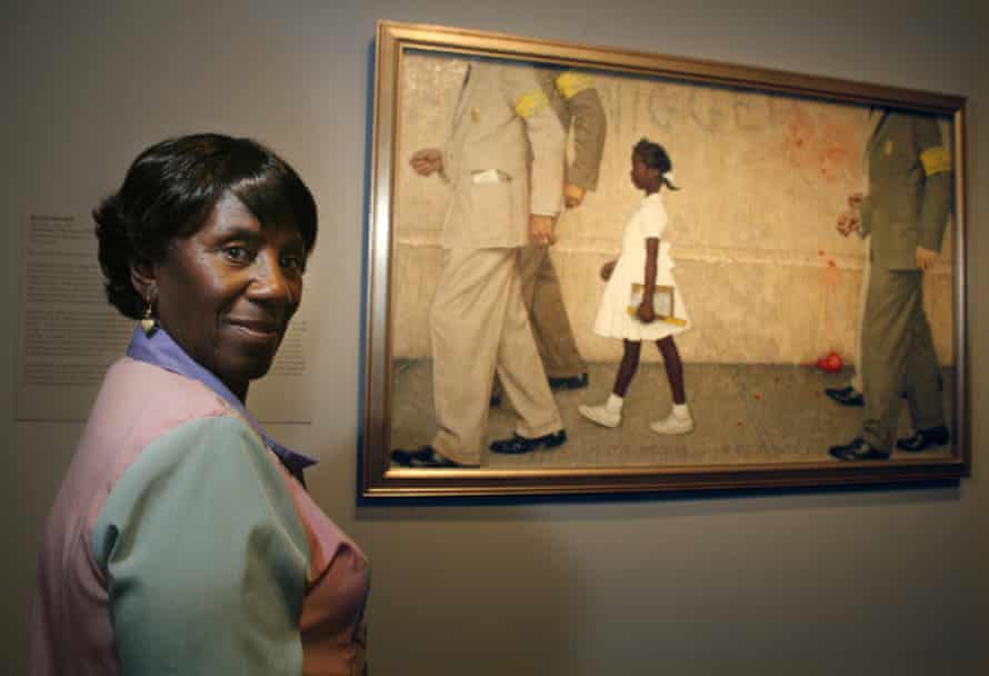 Ruby's mother, Lucille, next to the Norman Rockwell painting The Problem We All Live With.