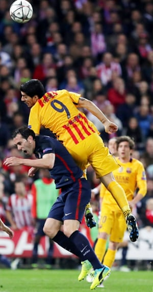 Atletico Madrid's Diego Godin (bottom) vies with Barcelona's Luis Suarez