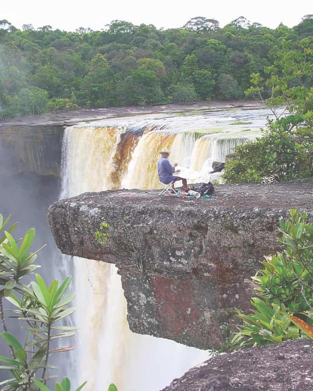 Tony Foster painting at Kaieteur Falls, Guyana.