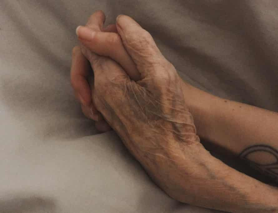 Gemma and Janet's hands clasped