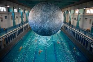 Rennes, France People swim under an artwork