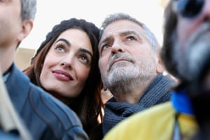 Amal and George Clooney attend the march in Washington, DC