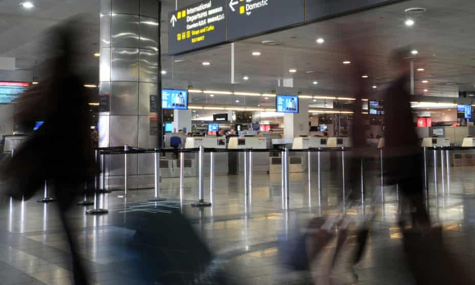 Airline passengers make their way through Melbourne airport