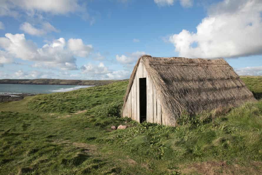 The last remaining thatched hut from the once booming cottage industry stands alone on the Pembrokeshire coastal path overlooking the beach of Freshwater West.